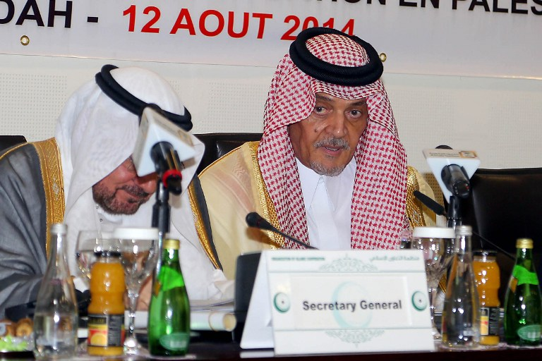 Saudi Foreign Minister Prince Saud al-Faisal, right, attends a ministerial meeting of the Organization of Islamic Cooperation, to discuss developments in the war-battered Gaza Strip on August 12, 2014 in Jeddah. (photo credit: AFP/STR)