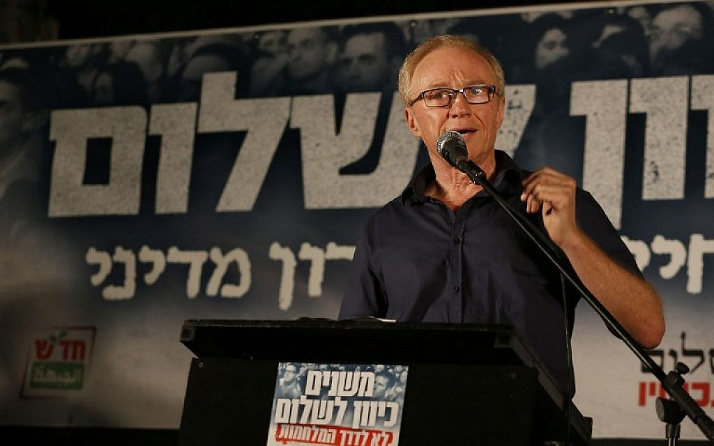Israeli author David Grossman addresses the crowd at a left-wing rally in Tel Aviv, Saturday night, August 16, 2014 (photo credit: AFP/GALI TIBBON)