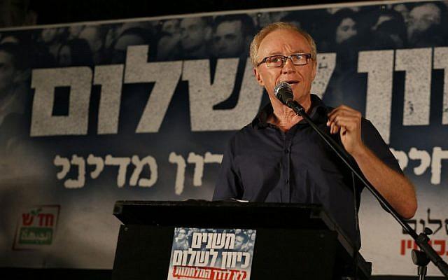 Israeli author David Grossman addresses the crowd at a left-wing rally in Tel Aviv, Saturday night, August 16, 2014 (photo credit: AFP/GALI TIBBON)