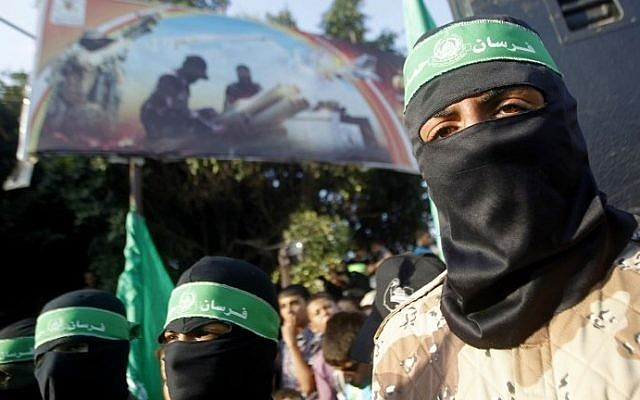 Palestinian masked supporters of the Islamist Hamas movement take part in a demonstration in Rafah in southern Gaza Strip in August 2014. (photo credit: AFP/SAID KHATIB)