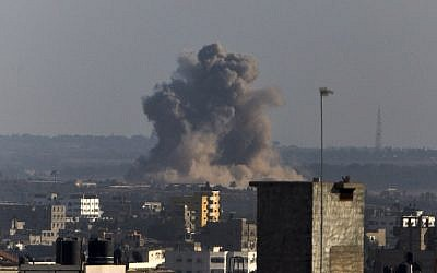 Smoke rises from buildings following an Israeli air strike on Gaza City on August 20, 2014. (photo credit: AFP/MAHMUD HAMS)