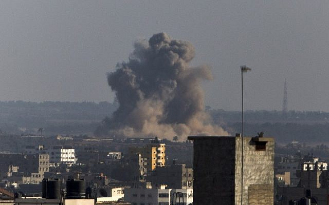 Smoke rises from buildings following an Israeli air strike on Gaza City on August 20, 2014. (photo credit: AFP/MAHMUD HAMS)