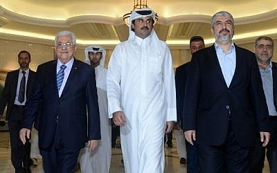 Palestinian Authority President Mahmoud Abbas (left) with Emir of Qatar Sheikh Tamim Bin Hamad al-Thani (center) and Hamas leader Khaled Mashaal (right) in Doha, Qatar, on August 21, 2014 (AFP/PPO/Thaer Ghanem)