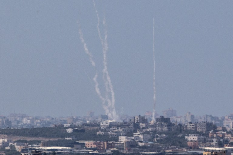 A photo from the Israeli side of the Israel-Gaza border shows a smoke trail of rockets being fired by Palestinian terrorists from the Gaza Strip into Israel, August 22, 2014. (AFP/Jack Guez)