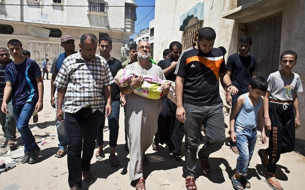 Palestinian Abu Bilal (C) carries the body of his one-and-a-half year old granddaughter during the funeral procession in Gaza City on August 24, 2014. (photo credit: AFP PHOTO/ ROBERTO SCHMIDT)