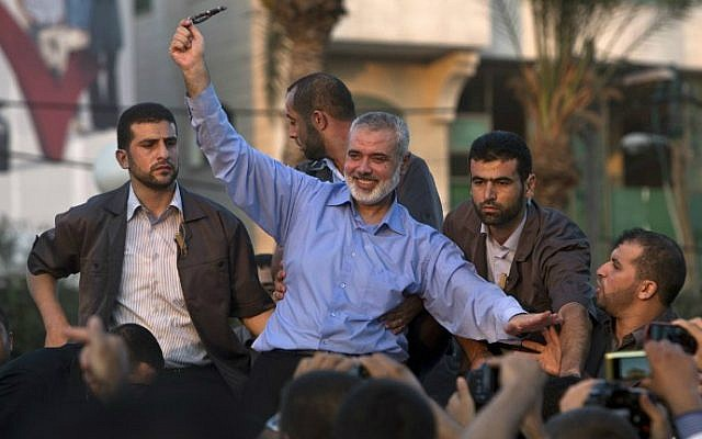 Ismail Haniyeh waves to the crowd during a rally in Gaza City on August 27, 2014. (photo credit: AFP/Mahmud Hams)