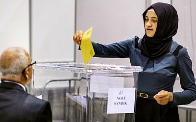 A woman casts her ballot for the Turkish presidential election in a polling station created in convention center Ahoy in Rotterdam on July 31, 2014. (photo credit: AFP/ANP/REMKO DE WAAL)