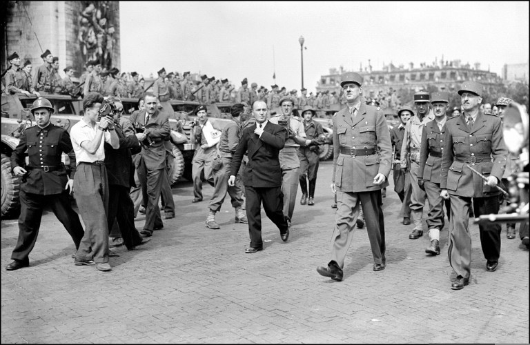 A file picture taken on August 26, 1944 shows French Generals de Gaulle (3rdR) and Leclerc (R) preparing to march down the Champs Elysees to join Notre Dame Cathedrale the day after the Liberation of Paris. In the background : General Pierre Koenig and Colonel Louis Dio. (photo credit: AFP/File)