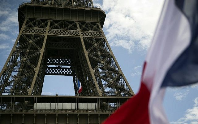 French flags next to the Eiffel Tower, in Paris, on August 19, 2014, mark the 70th anniversary of the liberation of France. (photo credit: AFP/Joel Saget)