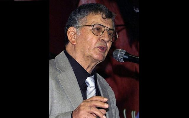 Druze poet Samih al-Qasim reads a poem during a literary evening marking 40 days since the death of his compatriot, Mahmoud Darwish, in Tunis, September 2008. Al-Qasim passed away on August 19, 2014, following a battle with cancer. (photo credit: Fethi Beladi/AFP)