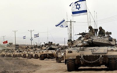 Israeli Merkava tanks drive near the border between Israel and the Gaza Strip as they return from the Hamas-controlled Palestinian coastal enclave on August 5, 2014, after Israel announced that all of its troops had withdrawn from the Gaza Strip. (AFP/THOMAS COEX)