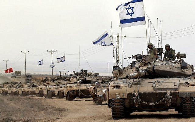 Israeli Merkava tanks drive near the border between Israel and the Gaza Strip as they return from the Hamas-controlled Palestinian coastal enclave on August 5, 2014, after Israel announced that all of its troops had withdrawn from the Gaza Strip. (photo credit: AFP/THOMAS COEX)