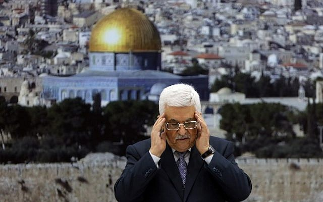 Palestinian Authority President Mahmoud Abbas recites a prayer in memory of those killed during the Gaza campaign ahead of a press conference on August 26, 2014 in the West Bank city of Ramallah, to formally announce a ceasefire with Israel.  (photo credit: AFP/Abbas Momani)