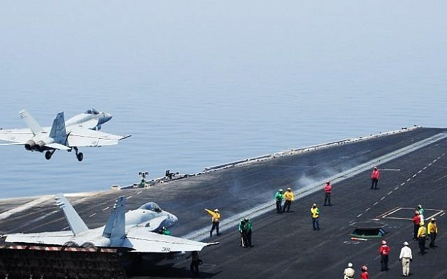An F/A-18E Super Hornet takes off from the flight deck of the aircraft carrier USS George H.W. Bush (CVN 77)on August 1, 2014 in the Gulf (Photo credit: AFP/US NAVY/Joshua Card)