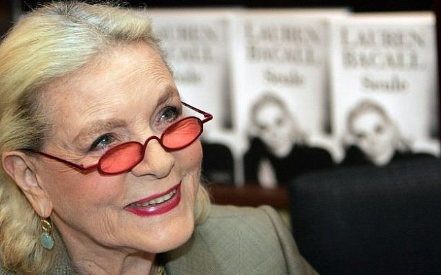 This May 7, 2005 file photo shows US actress Lauren Bacall signing copies of her autobiography at a book shop in Paris, France. (Photo credit: AFP/PIERRE ANDRIEU / Files)