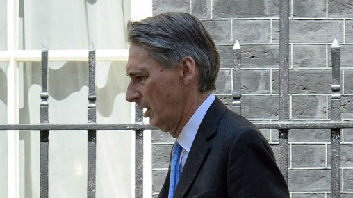 British Foreign Minister Philip Hammond leaves number 10, Downing Street in central London on July 29, 2014. (photo credit: AFP/Leon Neal)