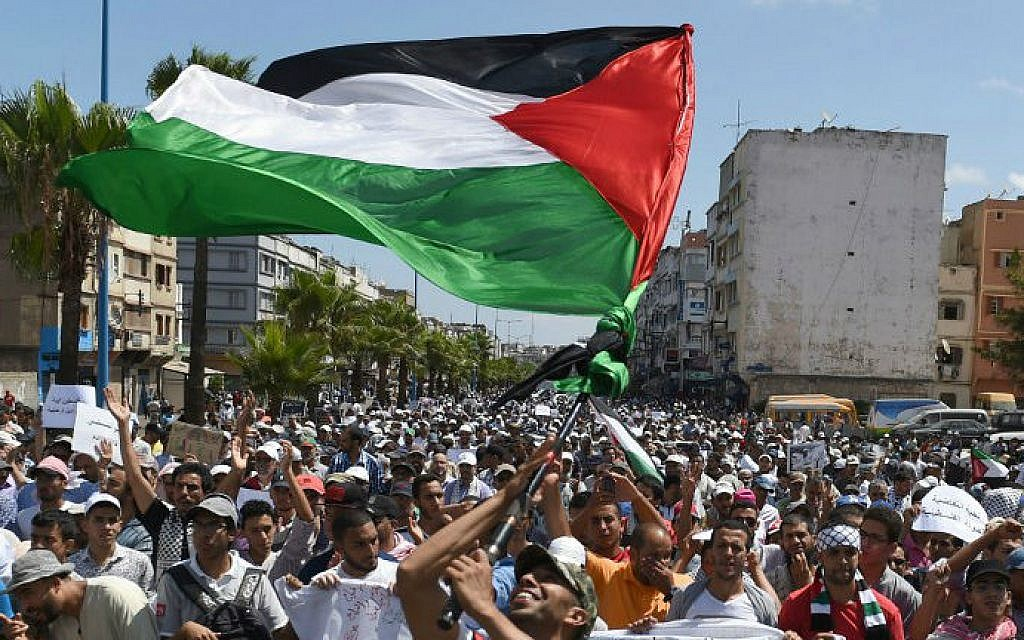 Moroccans hold placards and wave flags during a demonstration, against Israel's military campaign in Gaza, organized by the Islamic group Al Adl Wal Ihsane (Justice and Spirituality) in Casablanca on August 3, 2014.  (photo credit: AFP/FADEL SENNA)