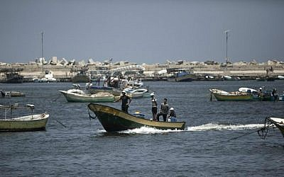 Palestinian fishermen arrive back from fishing in the port of Gaza City on August 5, 2014, after a 72-hour truce agreed by Israel and Hamas went into effect. (AFP/Mahmud Hams)