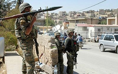 Lebanese troops stand guard in a street on August 9, 2014 in the eastern Lebanese town of Arsal, on the border with Syria. (photo credit: AFP/STR)