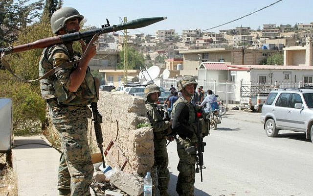 Lebanese troops stand guard in a street on August 9, 2014, in the eastern Lebanese town of Arsal, on the border with Syria. (photo credit: AFP/STR)