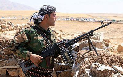 File: An Iraqi Kurdish peshmerga fighter takes up position in the town of Bashiqa, 13 kilometers northeast of Mosul, on August 12, 2014. (AFP/Ahmad al-Rubaye)
