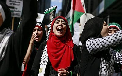 Protesters march as they take part in a demonstration against military action in Gaza on August 9, 2014 in New York City (photo credit: Kena Betancur/Getty Images/AFP)