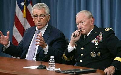 US Secretary of Defense Chuck Hagel (L) and Chairman of the Joint Chiefs of Staff General Martin Dempsey speak to the media during a press briefing at the Pentagon August 21, 2014 in Arlington, Virginia. (photo credit: Mark Wilson/Getty Images/AFP)