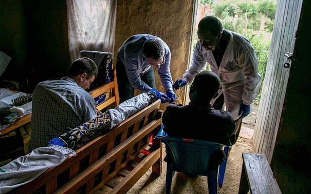 Dr. Leslie Lobel visits an Ebola survivor in his home. (Photo credit: Eric Weiss/Courtesy of Leslie Lobel)