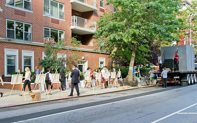 The organizers of 'Art Vigil' set up easels along a busy walkway in New York's Village. (courtesy)