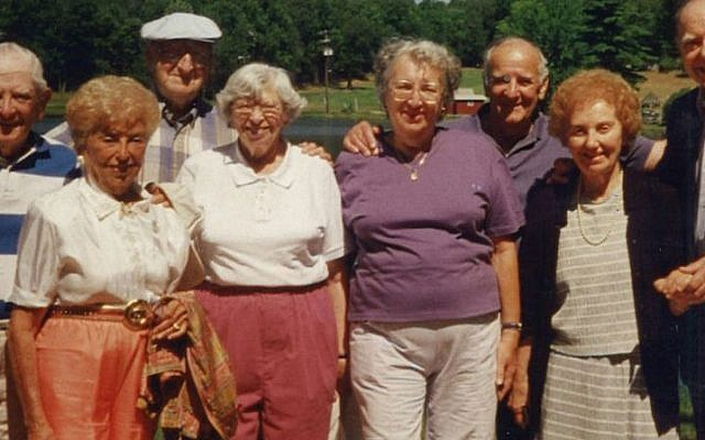 This photograph dated August 2001, which JTA's Uriel Heilman found affixed to a mirror in one of the bedrooms of the derelict bungalow colony, shows Nat and Sylvia Goldberg, at left, at the bungalow colony with three other couples identified only as Herman & Eleanor, Milton & Norma and Jack & Charlotte.