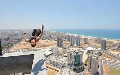 Sergey, 24, doing a backflip on a skyscraper in Ashdod (photo credit: YouTube screen grab)