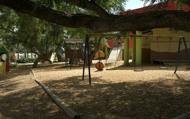 A picture taken on August 4, 2014 shows an empty playground in the southern Israeli kibbutz of Kfar Aza (photo credit: AFP/ Gil Cohen-Magen)