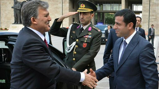 Turkish Kurdish presidential candidate for Aug. 10 election, Selahattin Demirtas, right, welcomes Turkish President Abdullah Gul outside the parliament in Ankara, Turkey, Thursday, Aug. 7, 2014 (photo credit: AP)