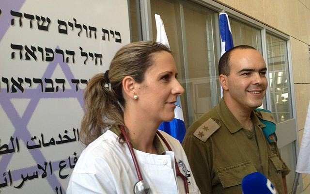 Lt. Col. Rachel Mezan of the IDF Medical Corps (left) and Lt. Col. Sharon Biton o COGAT (right) at the Erez field hospital, August 1, 2014 (photo credit: Elhanan Miller/Flash90)