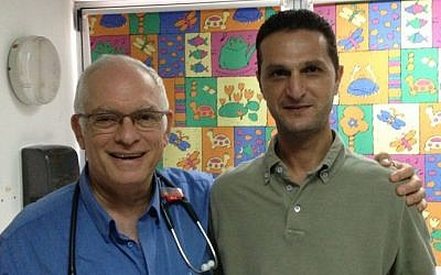Akiva Tamir left) and Khaled Obeid at Wolfson Hospital in Holon, August 12, 2014 photo credit: Elhanan Miller/Times of Israel staff)