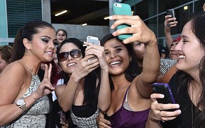 Selena Gomez, left, arriving at the premiere of Mad Chance's 'Behaving Badly' at the ArcLight Cinema in Hollywood, Calif., July 29, 2014 . (Alberto E. Rodriguez/Getty Images/JTA)