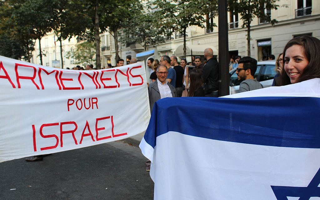 Armenians stand with Israel at the pro-Israel rally on July 31, 2014. (Glenn Cloarec/The Times of Israel)