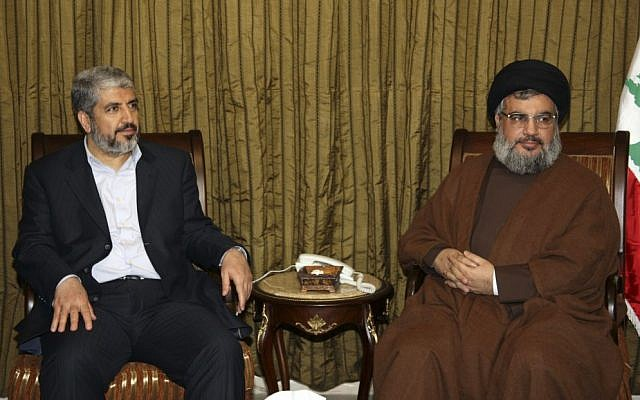 Hezbollah leader Sheik Hassan Nasrallah, right, meets with the political leader of Hamas Khaled Mashaal, left, in Beirut's southern suburb, Lebanon, January 15, 2010 photo credit: AP)