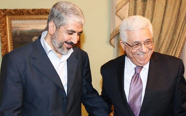 Khaled Mashaal, political leader of Hamas (left), meets with Palestinian Authority President Mahmoud Abbas in Cairo, Egypt, December 21, 2011. (photo credit: AP)