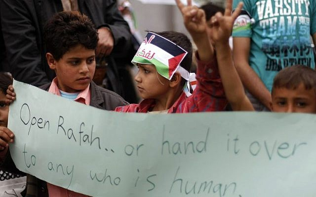 Yemeni boys attend a protest supporting Gaza in front of the Egyptian embassy in Sanaa, Yemen, August 5, 2014  [photo credit: AP/Hani Mohammed]