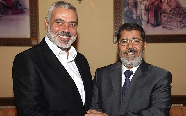 Egyptian President Mohammed Morsi, right, meets the Hamas Prime Minister of Gaza, Ismail Haniyeh in Cairo, Egypt, July 26, 2012 photo credit: AP)