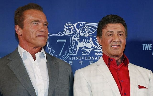 "Arnold Schwarzenegger and Sylvester Stallone pose on the red carpet for the premiere of their movie ""The Expendables 3"" in Macau, China, Friday, Aug. 22, 2014. The two are among 187 signatories on a new letter slamming Hamas. (photo credit: AP Photo/Kin Cheung)"