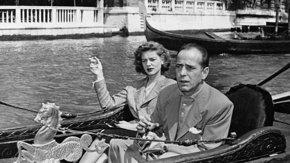 Humphrey Bogart, tough guy of the films, and his equally famous wife, Lauren Bacall, take things easy as they glide through Venice in a gondola during a visit to the Italian city of canals, May 31, 1951. (photo credit: AP Photo)