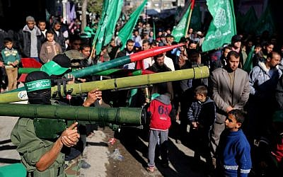 Members of the Izz Al-Din Al Qassam Brigades, the military wing of Hamas, attend a demonstration at Nuseirat Refugee Camp in the central Gaza Strip against resuming peace talks with Israel, January 24, 2014. (photo credit: AP/Hatem Moussa)