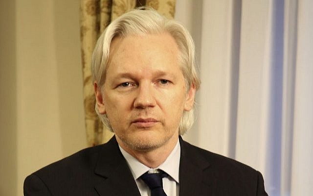In this July 30, 2013 file photo released by Sunshine Press Productions, WikiLeaks founder Julian Assange sits inside the Ecuadorian Embassy in London. (photo credit: AP/Sunshine Press Productions, File)