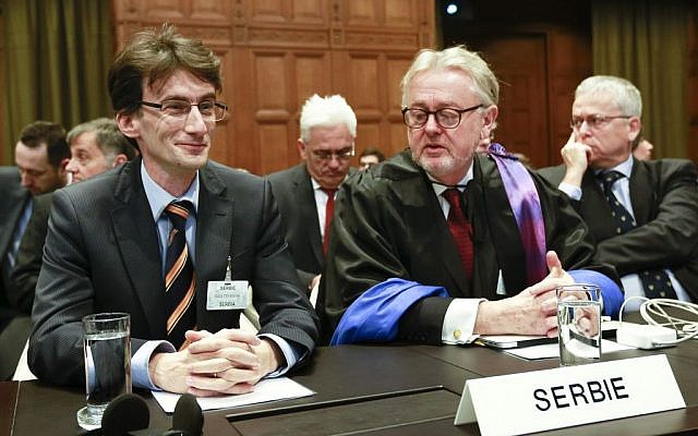 William Schabas, right, and members of a Serbian delegation at the International Court of Justice in The Hague, Netherlands in March. Schabas heads a UN Human Rights Commission inquiry into war crimes during the 2014 Gaza conflict (photo credit: AP/Jiri Buller)
