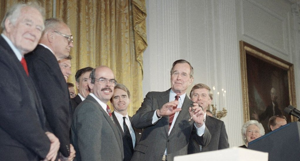 Rep. Henry Waxman (third from left) with George H. Bush after he signed the Clean Air Act of 1990, Thursday, November 15, 1990 in the White House East Room in Washington. (AP Photo/Charles Tasnadi)