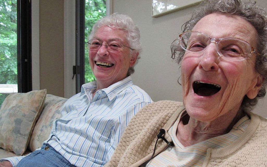 In this Friday, Aug. 1, 2014 photo, Lennie Gerber, left, and her spouse, Pearl Berlin, laugh while at their home in High Point, N.C.  (AP Photo/Allen G. Breed)