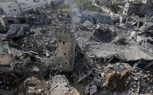 Smoke billows from the rubble of the Imam Al Shafaey mosque, destroyed in an overnight Israeli strike in Gaza City in the northern Gaza Strip on Saturday, Aug. 2, 2014. Israel said it hit five mosques in which rockets were hidden. (Photo credit: AP/Lefteris Pitarakis)