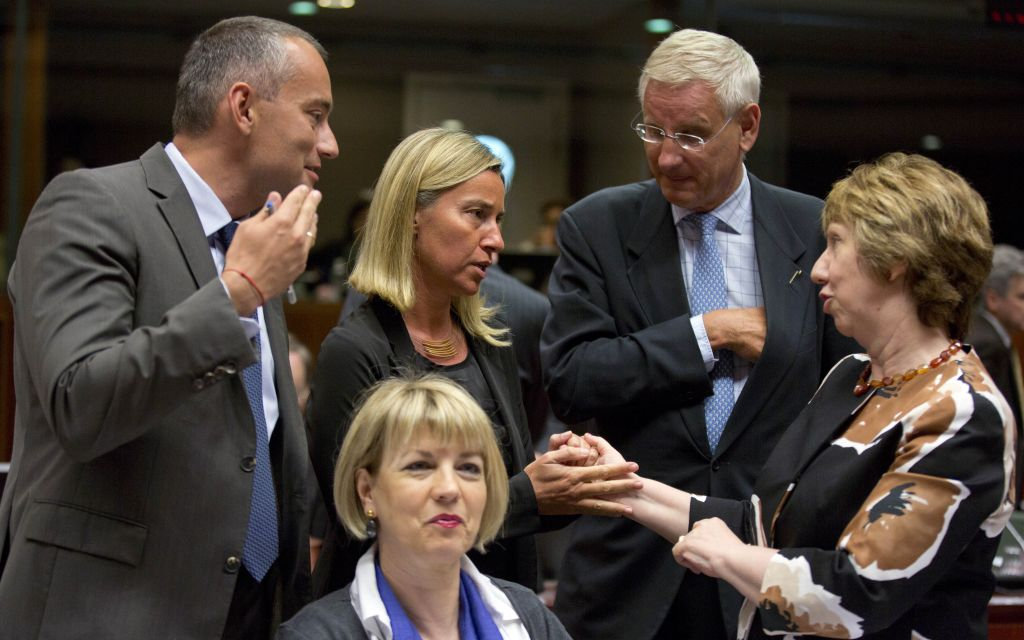 European Union High Representative Catherine Ashton, right, speaks with then Italian Foreign Minister Federica Mogherini, second left, and Swedish Foreign Minister Carl Bildt, second right, during a round table meeting of EU foreign ministers at the EU Council building in Brussels on Friday, Aug. 15, 2014. (photo credit: AP Photo/Virginia Mayo)